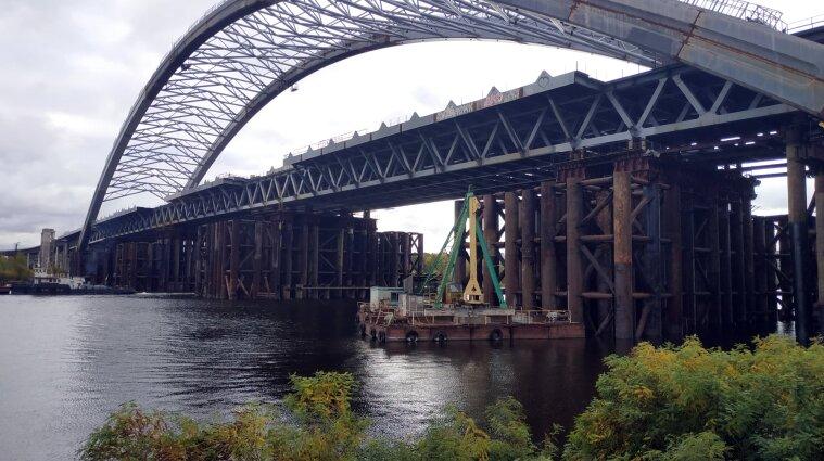 ДФС продовжує розслідування у справі будівництва Подільського моста